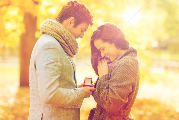 man proposing to a woman in the autumn park Stock photo © dolgachov