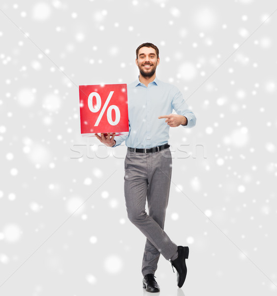 Souriant homme rouge pourcentage signe neige Photo stock © dolgachov