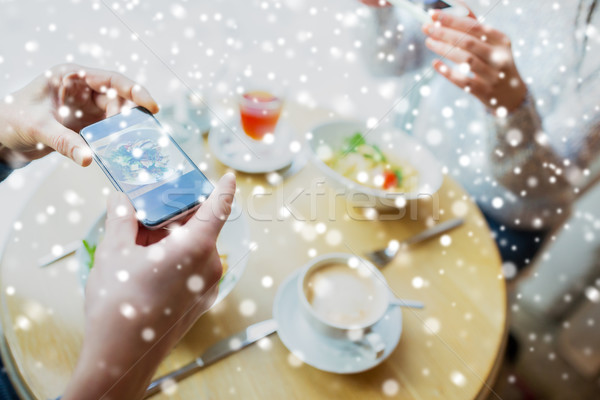 close up of couple picturing food by smartphone Stock photo © dolgachov