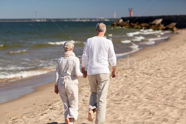 senior couple walking along summer beach Stock photo © dolgachov