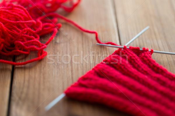 hand-knitted item with knitting needles on wood Stock photo © dolgachov
