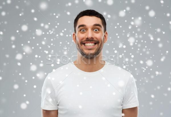 Férfi vicces arc hó tél karácsony emberek Stock fotó © dolgachov