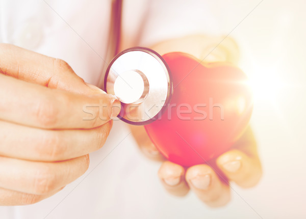 male hands holding red heart and stethoscope Stock photo © dolgachov