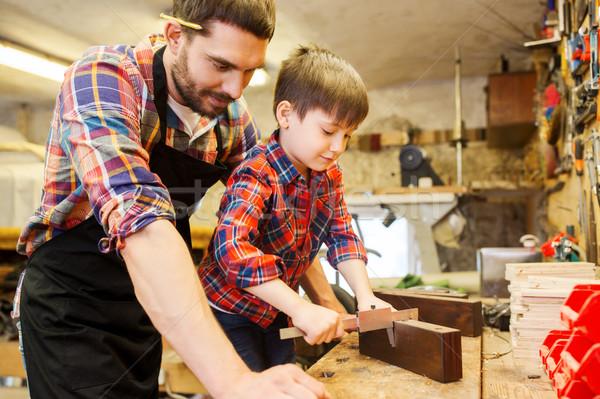 Fiú apa méret fa műhely család Stock fotó © dolgachov