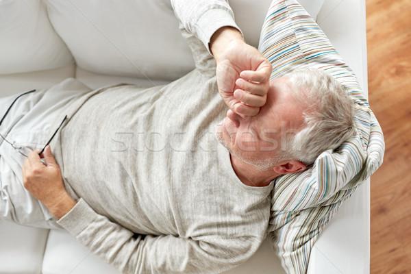 Közelkép fáradt idős férfi kanapé otthon Stock fotó © dolgachov