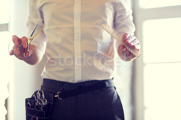 close up of male stylist with scissors at salon Stock photo © dolgachov
