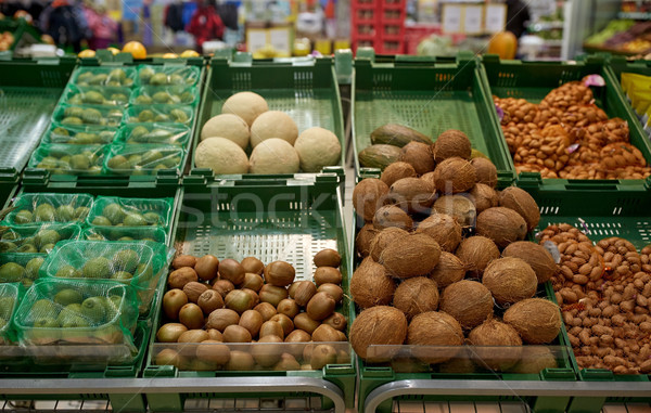 fruits and vegetables on stall at grocery store Stock photo © dolgachov