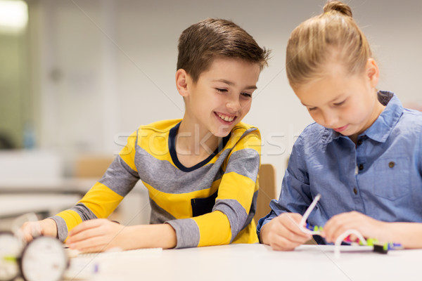 happy children building robots at robotics school Stock photo © dolgachov