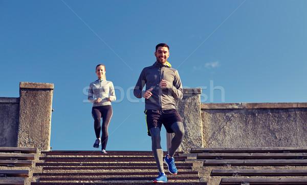 Feliz casal caminhada estádio fitness esportes Foto stock © dolgachov