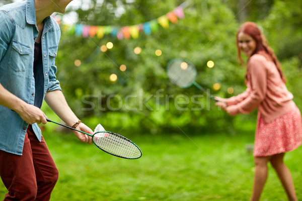 happy couple playing badminton at summer garden Stock photo © dolgachov