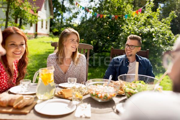 Zdjęcia stock: Szczęśliwy · znajomych · obiedzie · lata · garden · party · wypoczynku