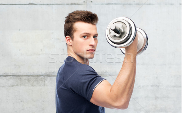 sportive man flexing muscles with dumbbell Stock photo © dolgachov