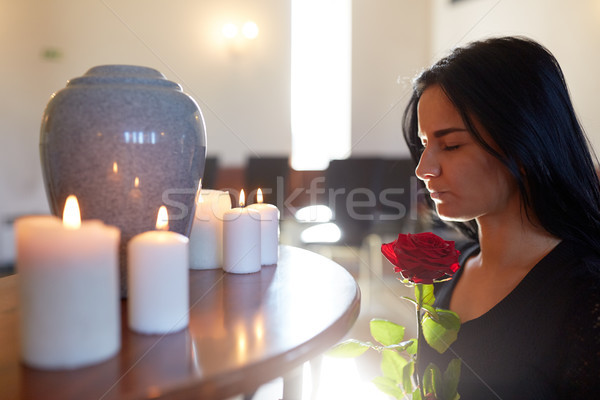 woman with rose and funerary urn at church Stock photo © dolgachov