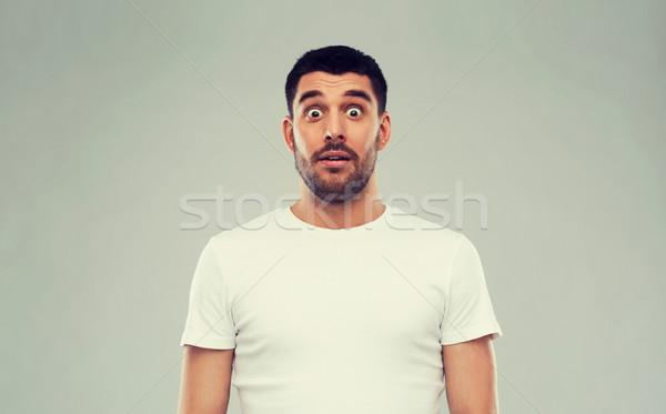 Paura uomo bianco tshirt grigio emozione Foto d'archivio © dolgachov