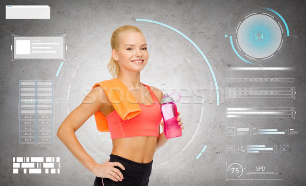 smiling sporty woman with water bottle and towel Stock photo © dolgachov