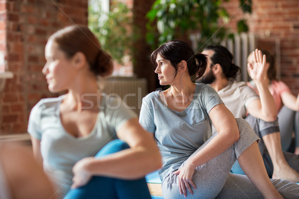 group of people doing yoga exercises at studio Stock photo © dolgachov
