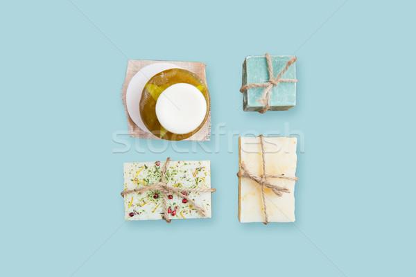 handmade soap bars over blue background Stock photo © dolgachov
