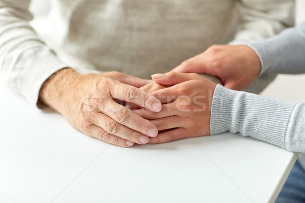 Yaşlı adam genç kadın el ele tutuşarak destek Stok fotoğraf © dolgachov