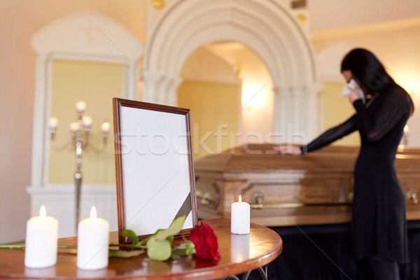 photo frame and woman crying at coffin at funeral Stock photo © dolgachov