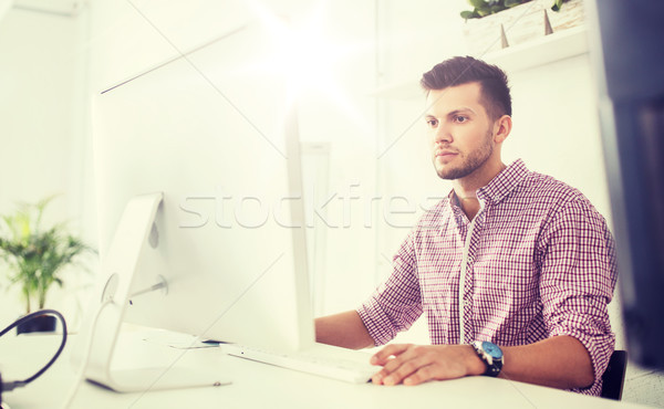 creative man or student with computer at office Stock photo © dolgachov