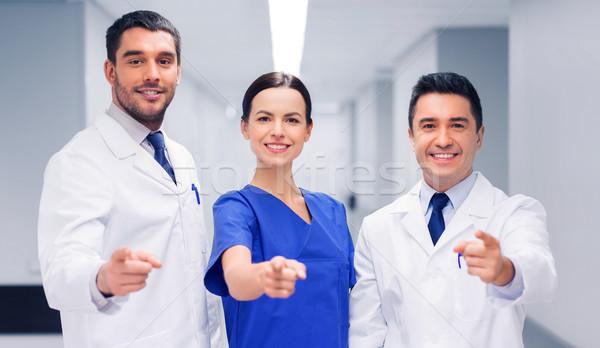 group of medics pointing finger on you at hospital Stock photo © dolgachov