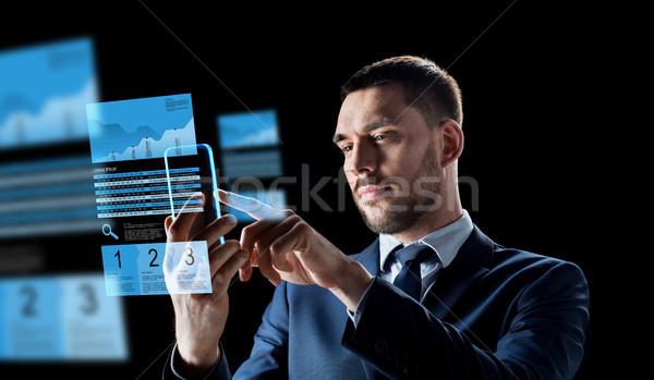 бизнесмен смартфон обмена бизнеса реальность Сток-фото © dolgachov