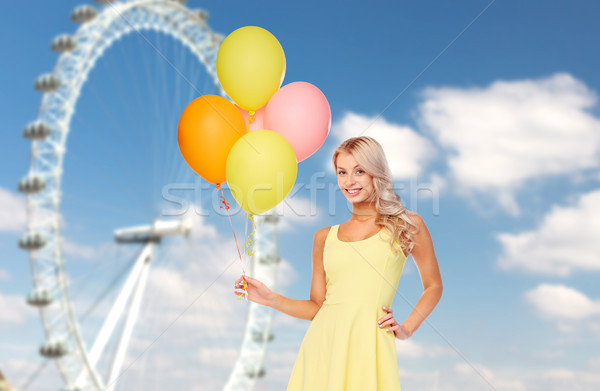 happy woman with air balloons over ferris wheel Stock photo © dolgachov