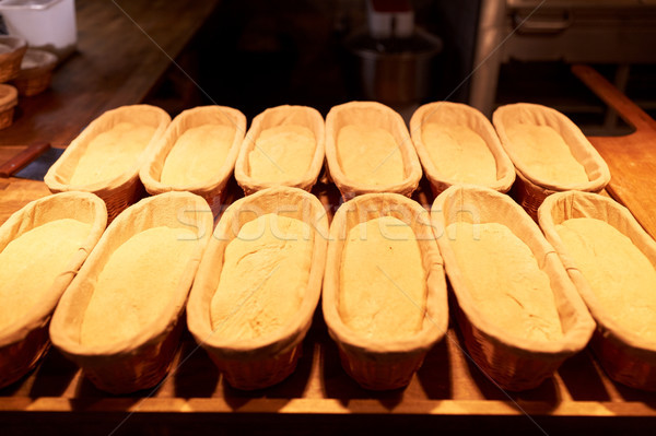 yeast bread dough in baskets at bakery kitchen Stock photo © dolgachov