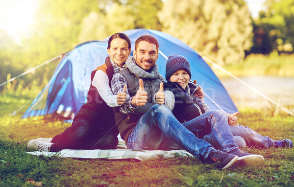happy family with tent at camp site Stock photo © dolgachov