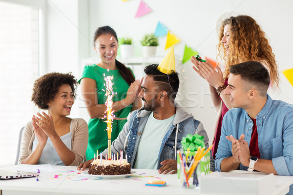 team greeting colleague at office birthday party Stock photo © dolgachov