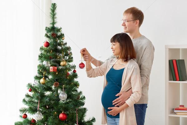 Stok fotoğraf: Mutlu · hamile · eş · koca · noel · ağacı · gebelik