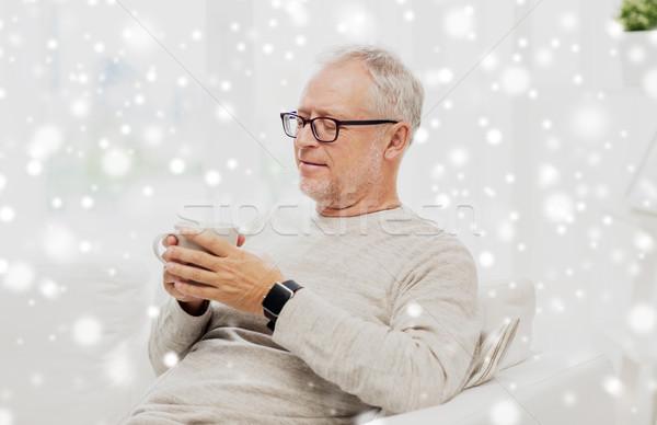 Boldog idős férfi csésze tea otthon Stock fotó © dolgachov