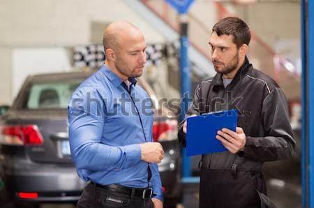 auto mechanic and customer looking at car Stock photo © dolgachov