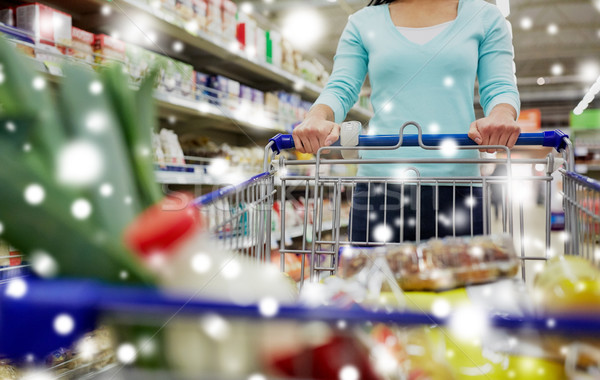 customer with food in shopping cart at supermarket Stock photo © dolgachov