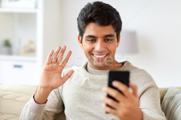 happy man having video call on smartphone at home Stock photo © dolgachov