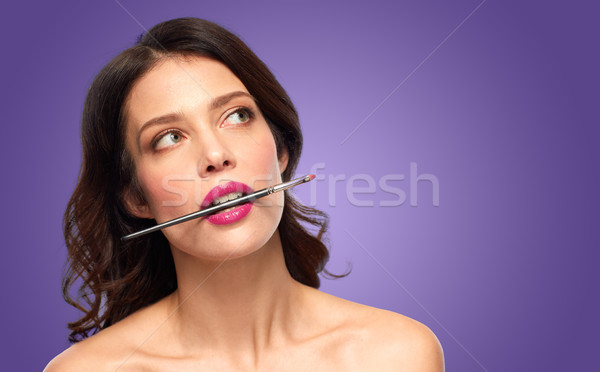 beautiful woman with make up brush for lipstick Stock photo © dolgachov