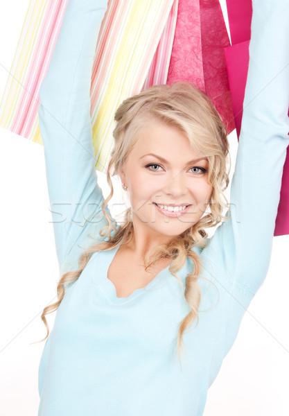 買い物客 幸せ 女性 ショッピングバッグ 白 女性 ストックフォト © dolgachov