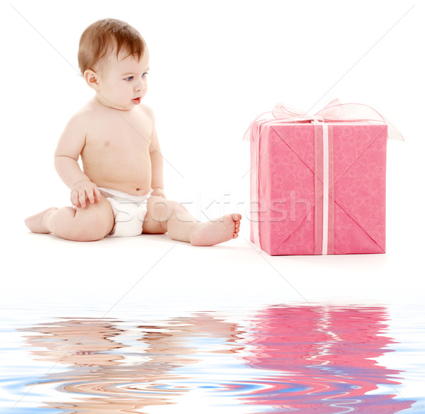 Stock photo: baby boy in diaper with big gift box