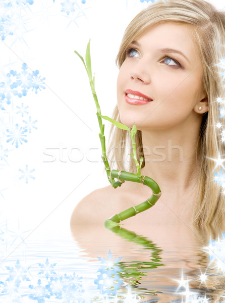 blue-eyed blonde with bamboo in water Stock photo © dolgachov