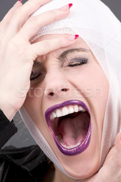 Sérülés kép sikít sebesült női arc szürke Stock fotó © dolgachov