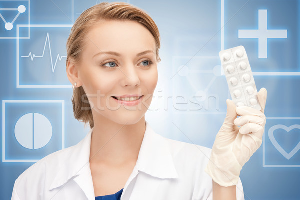 attractive female doctor with pills Stock photo © dolgachov