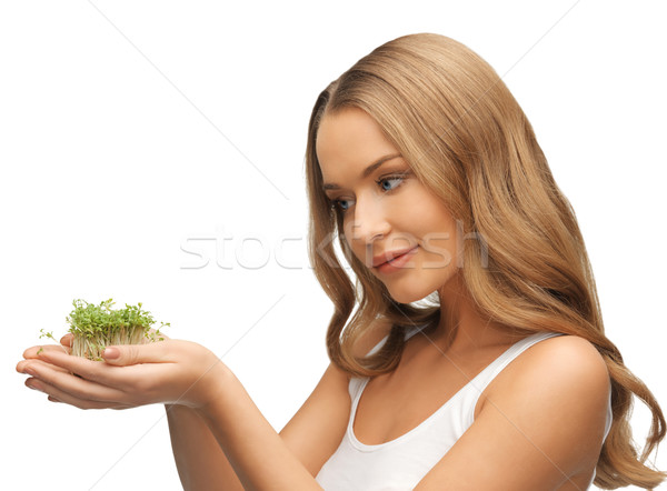 woman with green grass on palms Stock photo © dolgachov