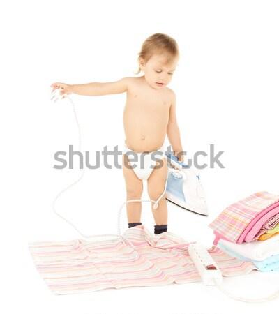 baby plugging in iron Stock photo © dolgachov