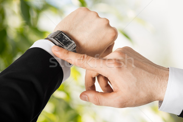 man looking at wristwatch Stock photo © dolgachov