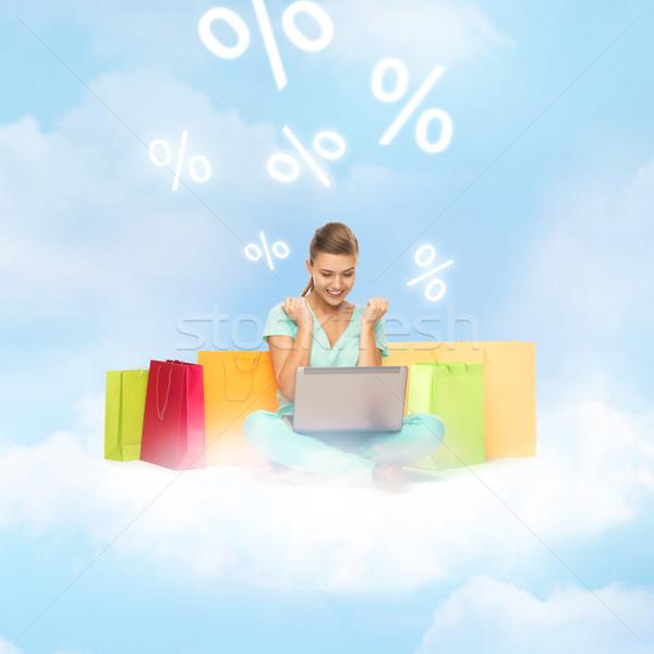 女性 インターネットショッピング 将来 技術 ノートパソコン ショッピングバッグ ストックフォト © dolgachov