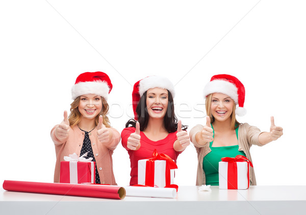 Stock fotó: Mosolyog · nők · mikulás · segítő · sapkák · ajándékdobozok