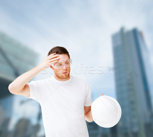 male architect in safety glasses taking off helmet Stock photo © dolgachov