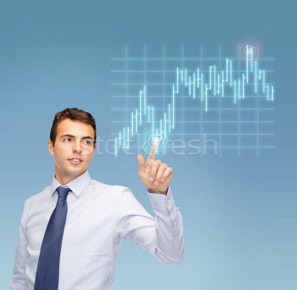 man working with forex chart on virtual screen Stock photo © dolgachov
