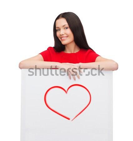 Mosolyog fiatal lány fehér tábla szeretet boldogság emberek Stock fotó © dolgachov