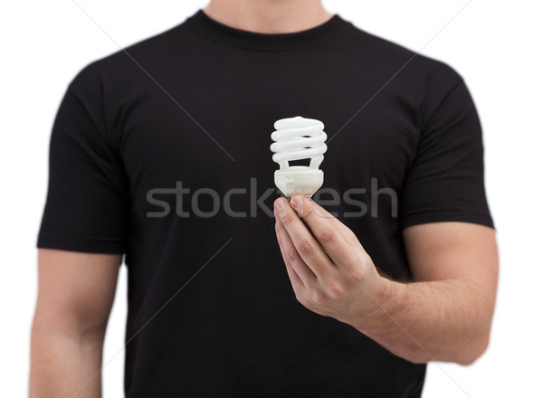 close up of man holding light bulb Stock photo © dolgachov